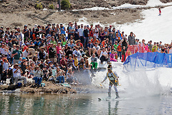 """""""Cushing Classic at Squaw Valley 5"""" - Photograph of a skier crossing a pond during the Cushing Classic at Squaw Valley, USA."""