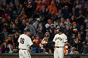 San Francisco Giants third baseman Eduardo Nunez (10) celebrates with San Francisco Giants third base coach Phil Nevin (16) after hitting a triple against the Pittsburgh Pirates at AT&T Park in San Francisco, California, on July 25, 2017. (Stan Olszewski/Special to S.F. Examiner)