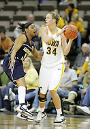 28 NOVEMBER 2007: Iowa forward Johanna Solverson (34) tries to pass the ball around Georgia Tech guard Jill Ingram (5) in the second half of Georgia Tech's 76-57 win over Iowa in the Big Ten/ACC Challenge at Carver-Hawkeye Arena in Iowa City, Iowa on November 28, 2007.