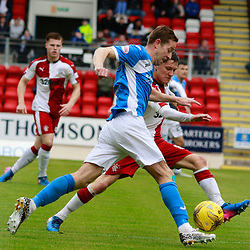 Steven MacLean does all he can to get past Myles Beerman