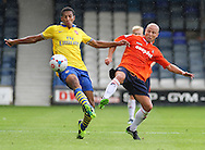 Picture by David Horn/Focus Images Ltd +44 7545 970036<br /> 03/08/2013<br /> Luke Gutteridge of Luton Town (right) and Isaac Hayden of Arsenal XI battle for the ball during the Friendly match at Kenilworth Road, Luton.