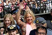 Canal Parade 2013 in de Amsterdamse grachten. De Canal Parade is het hoogtepunt van de Gay Pride, een feestweek met voornamelijk homo's, bi's, lesbiennes en transgenders.<br /> <br /> On the photo: <br /> <br />  minister van Defensie, Jeanine Hennis-Plasschaert