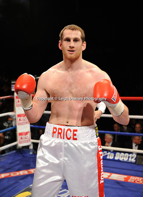 David Price (white shorts) defeats Osborne Machimana  at Brentwood Centre, Brentwood, Essex on the 5th February 2011. Frank Maloney Promotions. Photo credit © Leigh Dawney
