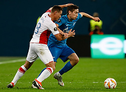 October 4, 2018 - Saint Petersburg, Russia - Daler Kuzyaev (R) of FC Zenit Saint Petersburg and Jan Boril of SK Slavia Prague vie for the ball during the Group C match of the UEFA Europa League between FC Zenit Saint Petersburg and SK Sparta Prague at Saint Petersburg Stadium on October 4, 2018 in Saint Petersburg, Russia. (Credit Image: © Mike Kireev/NurPhoto/ZUMA Press)