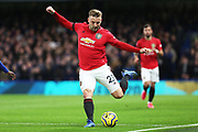 Manchester United defender Luke Shaw passes the ball during the Premier League match between Chelsea and Manchester United at Stamford Bridge, London, England on 17 February 2020.