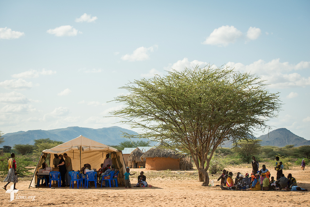Patients wait near a treatment tent at the LCMS Mercy Medical Team on Monday, June 20, 2016, in Nataparkakono, a village in Turkana, Kenya.  LCMS Communications/Erik M. Lunsford
