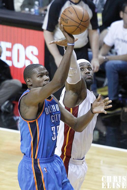 17 June 2012: Oklahoma City Thunder small forward Kevin Durant (35) takes a jumpshot over Miami Heat small forward LeBron James (6) during the Miami Heat 91-85 victory over the Oklahoma City Thunder, in Game 3 of the 2012 NBA Finals, at the AmericanAirlinesArena, Miami, Florida, USA.