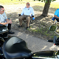 Tupelo Police Corporal Philip Sanderson, Sergeant Brett Moyer and Officer Patrick Johnson, sit and talk as they take a rest from riding their motorcycles through the training course. This also allows time for the cycles to cool off.