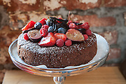 Chocolate, pistachio and coconut cake with figs and berries by Rebecca and Tom Woodram