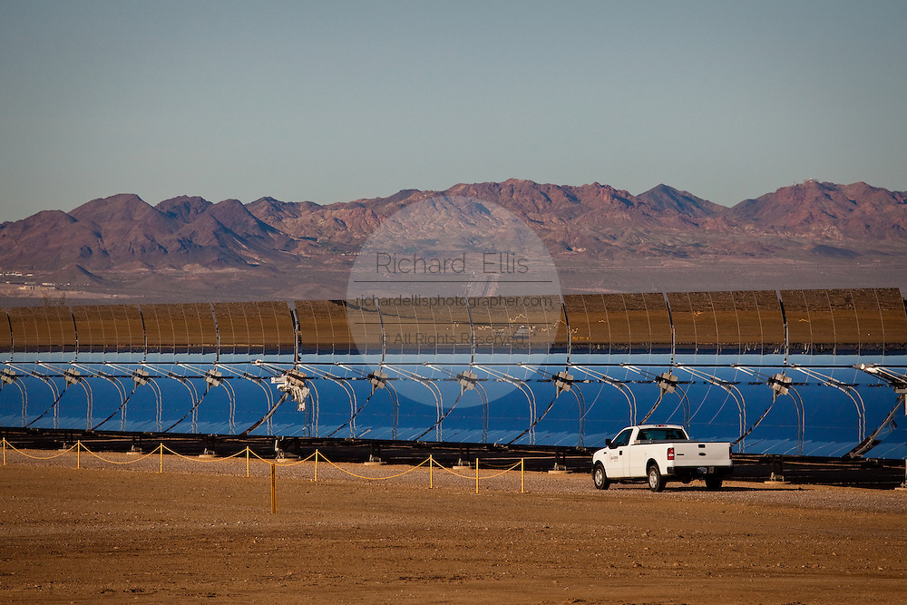 Nevada Solar One generating station, the largest concentrated solar power plant in the world using parabolic troughs in Boulder City, Nevada, USA. The plant has a maximum capacity of 75 MW.  Nevada Solar One uses 760 parabolic troughs (using more than 180,000 mirrors) made by Flabeg AG in Germany that concentrate the sun's rays onto thermos tubes placed at the focal axis of the troughs and containing a heat transfer fluid.