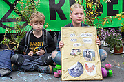 UNITED KINGDOM, London: 16 April 2019 <br /> Young Extinction Rebellion protesters show their support as protests continue on Waterloo Bridge today. It is the second day of protests that have appeared in five locations across the city. Police officers have made more than 120 arrests in the last 24 hours.<br /> Rick Findler / Story Picture Agency