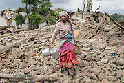 Devastating April 2015 Nepal Earthquake. Kirtipur Municipality, Kathmandu Valley. People digging with their bare hands through the remains of their homes in search of their belongings.
