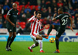 Eric Maxim Choupo-Moting of Stoke City tackles Fernandinho of Manchester City - Mandatory by-line: Robbie Stephenson/JMP - 12/03/2018 - FOOTBALL - Bet365 Stadium - Stoke-on-Trent, England - Stoke City v Manchester City - Premier League