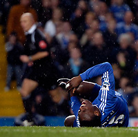 Photo: Ed Godden.<br />Chelsea v Fulham. The Barclays Premiership. 30/12/2006.<br />Chelsea's Michael Essien lies injured.