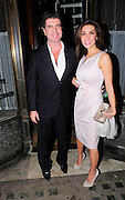 23.FEBRUARY.2011. LONDON<br /> <br /> SIMON COWELL AND FIANCE MEZHGAN HUSSAINY LEAVING MR CHOWS CHINESE RESTAURANT IN KNIGHTSBRIDGE.<br /> <br /> BYLINE: EDBIMAGEARCHIVE.COM<br /> <br /> *THIS IMAGE IS STRICTLY FOR UK NEWSPAPERS AND MAGAZINES ONLY*<br /> *FOR WORLD WIDE SALES AND WEB USE PLEASE CONTACT EDBIMAGEARCHIVE - 0208 954 5968*