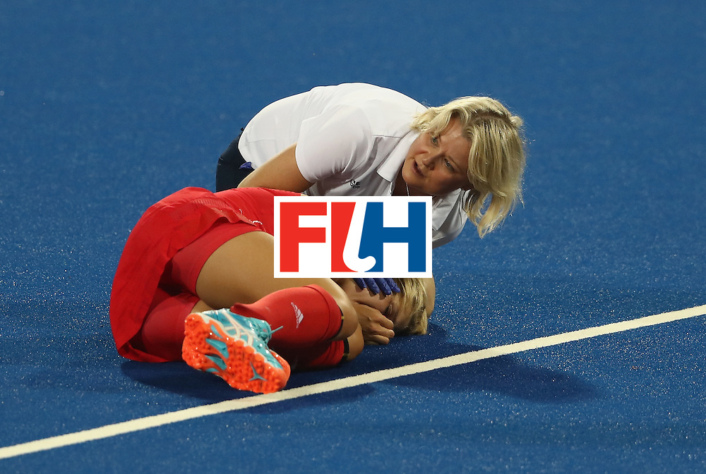 RIO DE JANEIRO, BRAZIL - AUGUST 17:  Georgie Twigg of Great Britain receives attention after being hit in face during the Women's hockey semi final match betwen New Zealand and Great Britain on Day12 of the Rio 2016 Olympic Games at the Olympic Hockey Centre on August 17, 2016 in Rio de Janeiro, Brazil.  (Photo by David Rogers/Getty Images)
