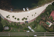 June 15, 2016 - Lake Buena Vista, FL, USA - Law enforcement boats and vehicles are seen at the Disney World beach where 2-year-old Lane Graves was pulled into Seven Seas Lagoon and killed by an alligator in Lake Buena Vista. The boy was pulled in by an alligator Tuesday night, and search efforts ended Wednesday when his body was recovered. <br /> ©Exclusivepix Media