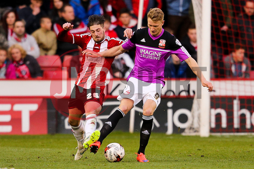 Kieron Freeman of Sheffield United and Michael Smith of Swindon Town in action  - Photo mandatory by-line: Matt McNulty/JMP - Mobile: 07966 386802 - 07/05/2015 - SPORT - Football - Sheffield - Bramall Lane - Sheffield United v Swindon Town - Sky Bet League One