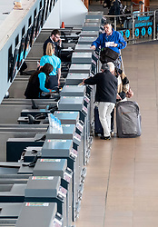 Passengers checking in at quiet check in desks operated by Ryanair at Prestwick Airport in Ayrshire, Scotland, UK