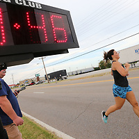 Ginger Berry crosses the line at Wednesday's annual Green Street Mile race in Tupelo.