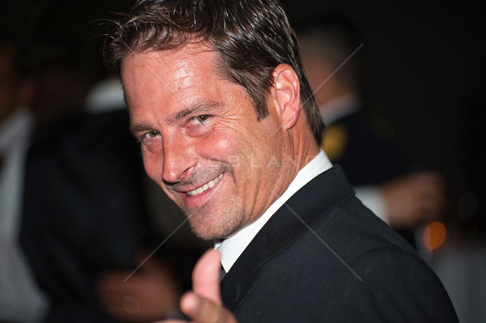 Man looking back over his shoulder smiling