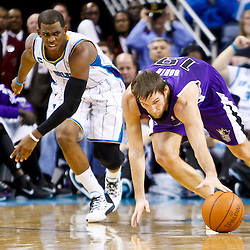 December 15, 2010; Sacramento Kings point guard Beno Udrih (19) and New Orleans Hornets point guard Chris Paul (3) scramble for a loose ball during the second half at the New Orleans Arena. The Hornets defeated the Kings 94-91. Mandatory Credit: Derick E. Hingle