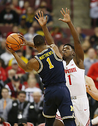 December 4, 2017 - Columbus, OH, USA - Ohio State Buckeyes forward Jae'Sean Tate (1) defends against Michigan Wolverines guard Charles Matthews (1) during the first half on Monday, Dec. 4, 2017, at Value Center Arena in Columbus, Ohio. (Credit Image: © Fred Squillante/TNS via ZUMA Wire)