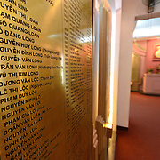 An indoor memorial for Vietnamese political prisoners held at Hoa Lo Prison under French colonial rule. At left is a large plaque mounted on the wall with the names of the prisoners. Hoa Lo Prison, also known sarcastically as the Hanoi Hilton during the Vietnam War, was originally a French colonial prison for political prisoners and then a North Vietnamese prison for prisoners of war. It is especially famous for being the jail used for American pilots shot down during the Vietnam War.