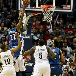 Feb 27, 2016; New Orleans, LA, USA; Minnesota Timberwolves guard Andrew Wiggins (22) shoots over New Orleans Pelicans guard Eric Gordon (10) and guard Jrue Holiday (11) and center Kendrick Perkins (5) during the fourth quarter of a game at  the Smoothie King Center. The Timberwolves defeated the Pelicans 112-110.  Mandatory Credit: Derick E. Hingle-USA TODAY Sports