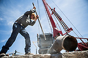 LA MESA, NM - APRIL 10, 2015:  Phil Archer chisels concrete to get a outlet to fit on a partially collapsed well on his farm. Archer will have to replace the well soon, one of two on his farm. CREDIT: Max Whittaker for The New York Times