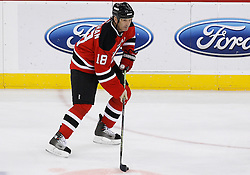 Feb 9, 2009; Newark, NJ, USA; New Jersey Devils left wing Brendan Shanahan (18) skates with the puck during the second period at the Prudential Center.