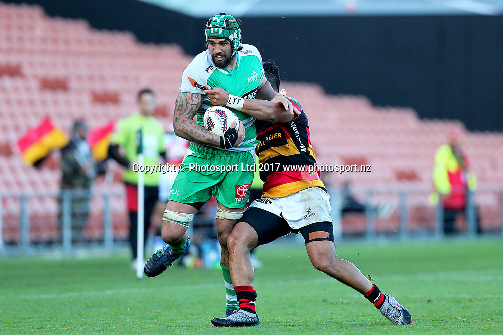 Manawatu lock Jackson Hemopo is tackled by Waikato reserve halfback Pele Cowley during the Mitre 10 Cup rugby match - Waikato v Manawatu played at FMG Stadium Waikato, Hamilton, New Zealand on Saturday 16 September 2017.  <br /> <br /> Copyright photo: &copy; Bruce Lim / www.photosport.nz