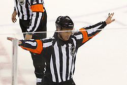 Jan 17, 2012; San Jose, CA, USA; NHL referee Mike Leggo (3) waves off a goal by San Jose Sharks defenseman Justin Braun (61) during the overtime period against the Calgary Flames at HP Pavilion. San Jose defeated Calgary 2-1 in shootouts. Mandatory Credit: Jason O. Watson-US PRESSWIRE