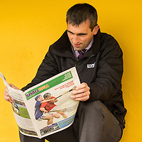 Tg4 GAA Beo presenter Cathal Moore reading the Clare People supplement during half time at Sundays County Hurling Final in Cusack Park