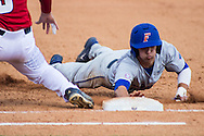 Dalton Guthrie head-first slides his way back to first base.( photo by Samuel Navarro)