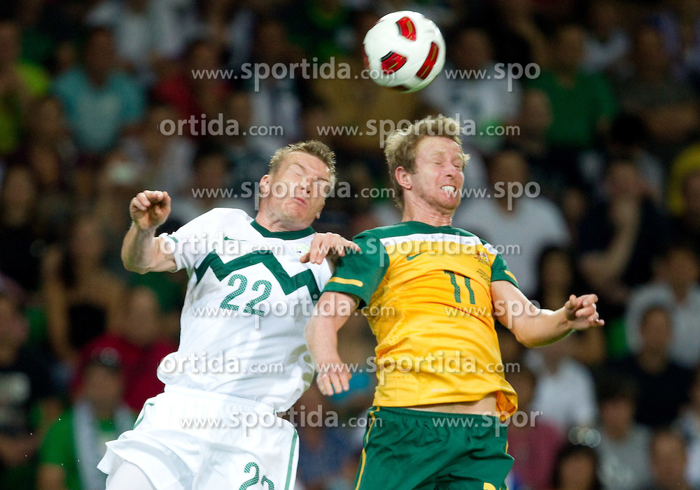 Matej Mavric Rozic of Slovenia vs David Carney of Australia during the opening friendly football match at a new stadium in Stozice between National teams of Slovenia and Australia on August 11, 2010 in Ljubljana. Slovenia defeated Australia 2-0. (Photo by Vid Ponikvar / Sportida)
