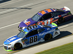 October 14, 2018 - Talladega, AL, U.S. - TALLADEGA, AL - OCTOBER 14: Alex Bowman, Hendrick Motorsports, Chevrolet Camaro LLumar (88) races with Denny Hamlin, Joe Gibbs Racing, Toyota Camry FedEx Ground (11) during the 1000Bulbs.com 500 on October 14, 2018, at Talladega Superspeedway in Tallageda, AL.(Photo by Jeffrey Vest/Icon Sportswire) (Credit Image: © Jeffrey Vest/Icon SMI via ZUMA Press)