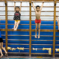 Chines students practice sports at the Shichahai Physical Education School Beijing, China, on Thursday, July. 31, 2008.<br /> Photographer: Bernardo De Niz