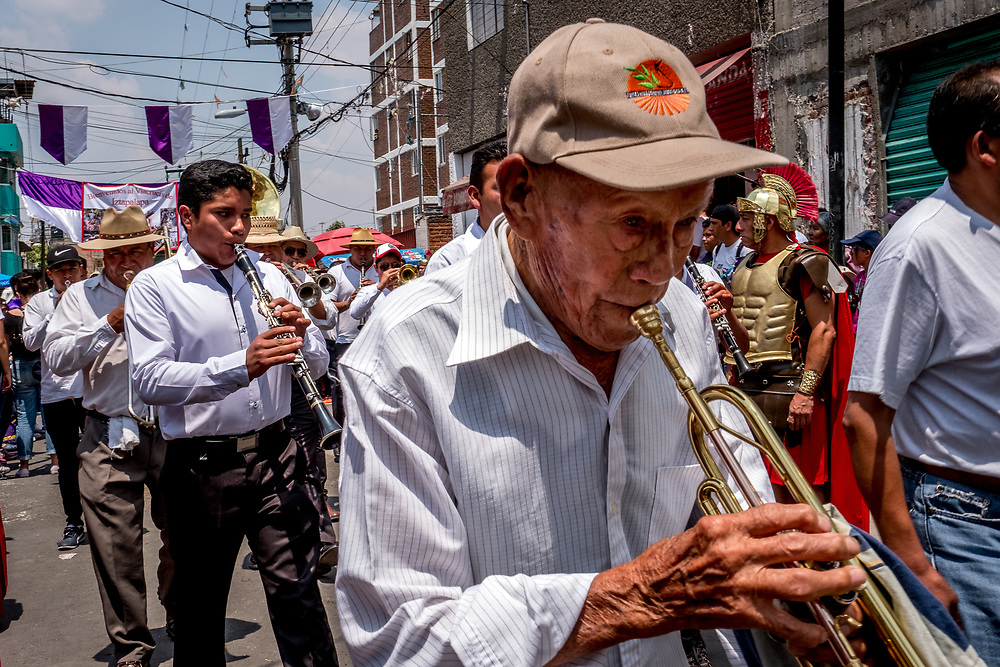 Local bands practice their marching songs for the annual Passion of the Christ procession. Participating in the event is seen as a sign of devotion and a point of pride for locals.