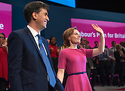 © Licensed to London News Pictures. 23/09/2014. Manchester, UK. Ed Miliband and Justine Thornton on stage after his speech.  Leader of the Labour Party Ed Miliband gives his leaders speech at the Labour Party Conference 2014 at the Manchester Convention Centre today 23 September 2014. Photo credit : Stephen Simpson/LNP
