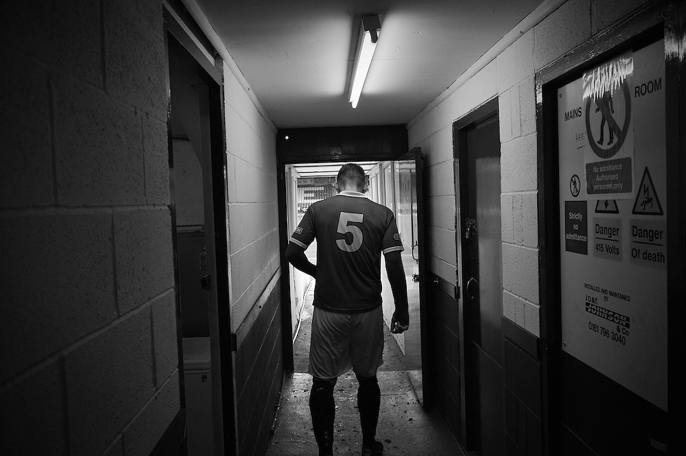 FC United of Manchester play a local team Chorley at Bury football club's ground in Lancashire, Britain. Photo shows Adam Jones an FC United of Manchester player in the tunnel leading to the pitch.