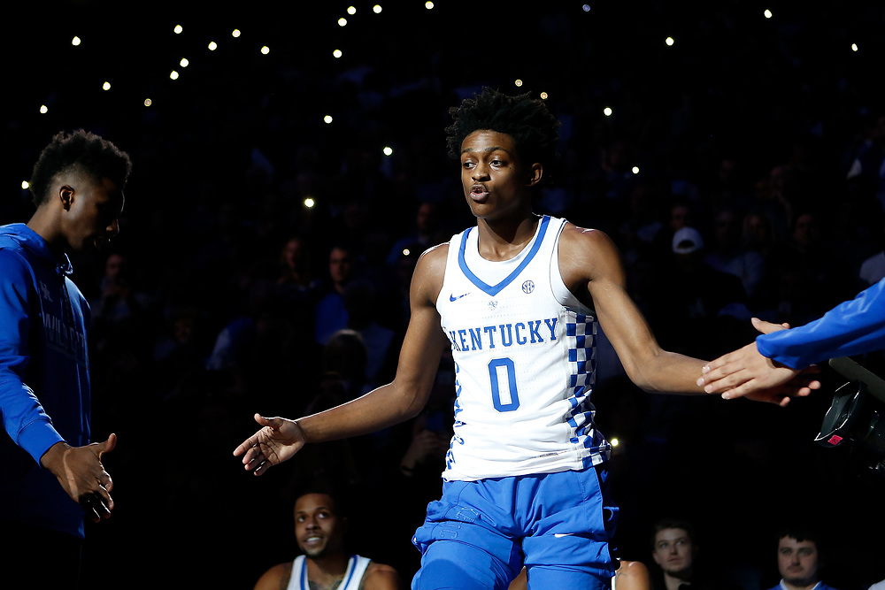 Kentucky Wildcats guard De'Aaron Fox high fives teammates during pregame introductions prior to the game against the Kansas Jayhawks on Saturday January 28, 2017 at Rupp Arena in Lexington, Ky. Photo by Michael Reaves | Staff