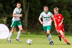 WREXHAM, WALES - Thursday, August 15, 2019: Wales' Alex Roberts and Northern Ireland's Connor Cunningham during the UEFA Under-15's Development Tournament match between Wales and Northern Ireland at Colliers Park. (Pic by Paul Greenwood/Propaganda)