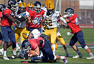 Central Bucks East's Evan Dorsey (9) is tackled by Central Bucks West's Jake Reichwein (33) late in the second quarter Saturday, October 21, 2017 at Central Bucks East in Buckingham, Pennsylvania. (Photo by William Thomas Cain)