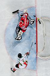 Nikandrosz Galanisz scores a goal on Bernhard Starkbaum of Austria during ice-hockey match between Hungary and Austria at IIHF World Championship DIV. I Group A Slovenia 2012, on April 19, 2012 at SRC Stozice, Ljubljana, Slovenia. (Photo By Matic Klansek Velej / Sportida.com)