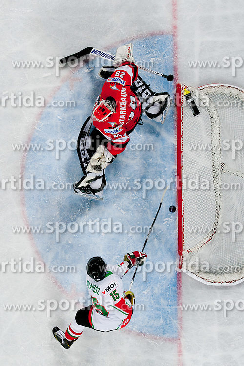 Nikandrosz Galanisz scores a goal on Bernhard Starkbaum of Austria during ice-hockey match between Hungary and Austria at IIHF World Championship DIV. I Group A Slovenia 2012, on April 19, 2012 at SRC Stozice, Ljubljana, Slovenia. (Photo By Matic Klansek Velej / Sportida.com)