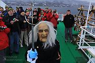 King Neptune prepares to baptise first-time Arctic Circle passengers aboard Hurtigruten coastal cruise ship sailing along northwest coast of Norway.