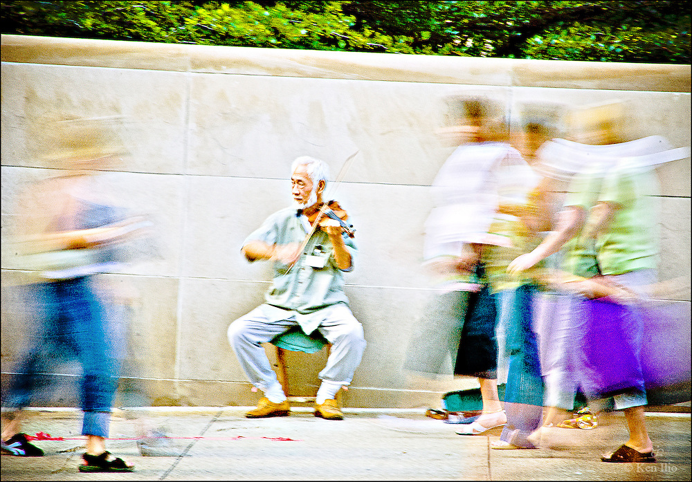 Chinese violinist busking on Jackson Blvd., July, 2005
