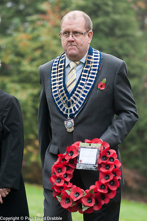 Chairman of Ecclesfield Parish Council Cllr Mr Jonathan Jones waits to lay a wreath at the War memorial in Chapeltown Park in Sheffield South Yorkshire up during the local Remembrance Day service 2011.13 November 2011. Image © Paul David Drabble