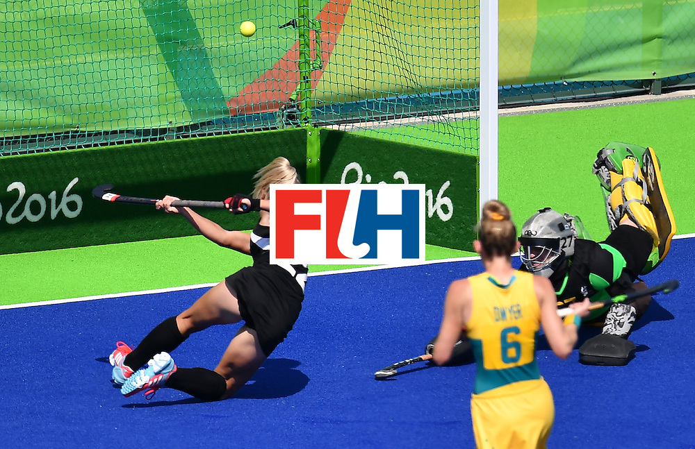 New Zealand's Gemma Flynn (L) scores her team's third goal during the the women's quarterfinal field hockey New Zealand vs Australia match of the Rio 2016 Olympics Games at the Olympic Hockey Centre in Rio de Janeiro on August 15, 2016. / AFP / MANAN VATSYAYANA        (Photo credit should read MANAN VATSYAYANA/AFP/Getty Images)
